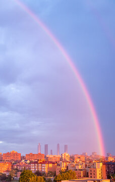 rainbow at sunrise over the skyline of the city of Madrid