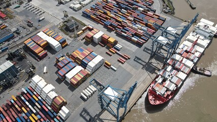 Tilbury Docks on River Thames UK container ships loading overhead aerial view  - fototapety na wymiar