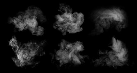 Fototapeta Fog or smoke set isolated on black background. White cloudiness, mist or smog background. obraz