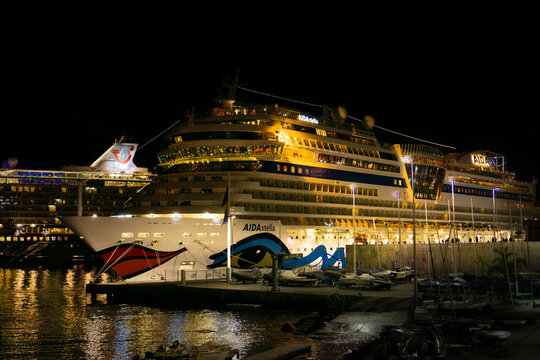 The cruise ship AIDA Stella in the port of Funchal, Madeira, Portugal, at night, December 17, 2019, with the cruise ship Mein Schiff 5 in the background