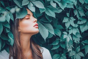 Fototapeta Beautiful fashion model girl enjoying nature, breathing fresh air in summer garden over Green leaves background. Harmony concept. Healthy beauty woman outdoor portrait obraz