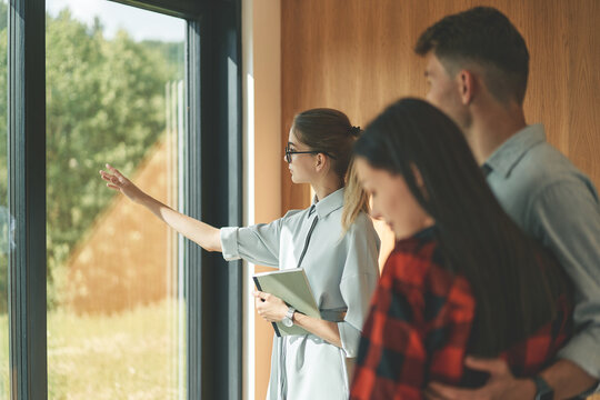 Successful real estate agent woman making presentation of house