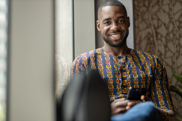 Portrait black African business man smiling, traditional clothing