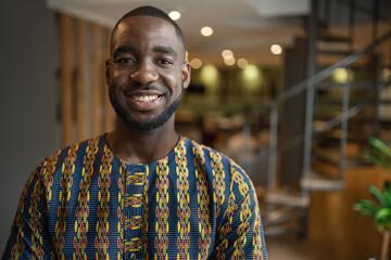 Portrait smiling black african businessman wearing traditional clothing - fototapety na wymiar