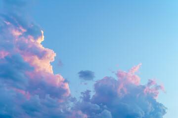 Pastel color clouds on blue sky background.