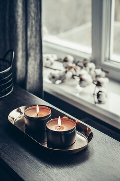 Burning candles on golden tray