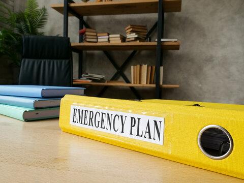 Emergency plan in the yellow folder on the desk.