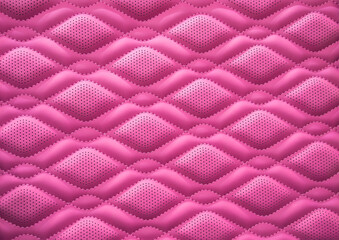 pink leather background and texture as a pattern for the interior car or a sofa or wall covering