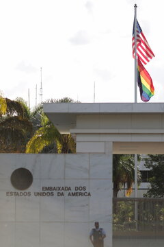 The LGBT flag is seen next to U.S. flag during International Day against Homophobia, at the U.S. Embassy in Brasilia