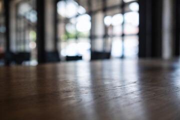 Obraz Wooden table top with blurred background in cafe - fototapety do salonu