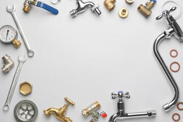 Obraz Frame made of plumber's items on light background - fototapety do salonu
