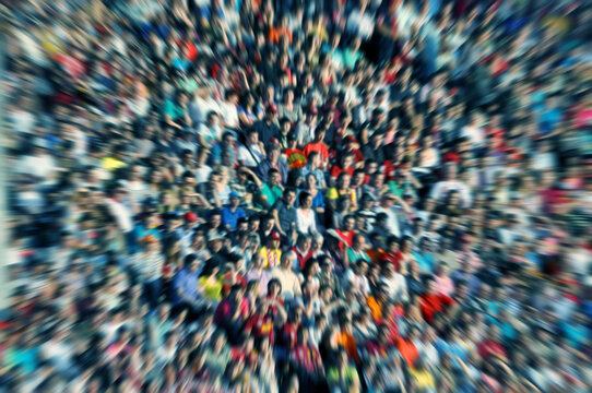Defocused background of crowd of people in a stadium