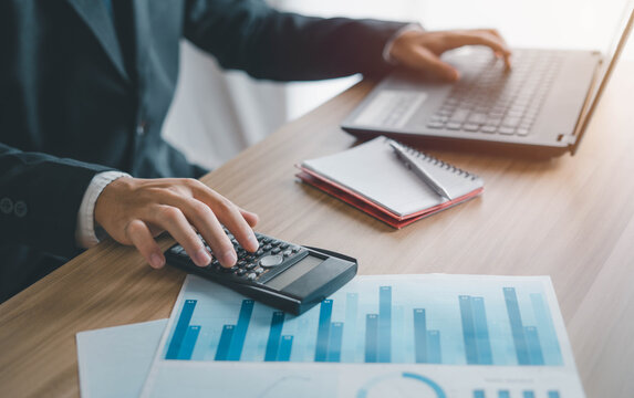 Business men use calculators to calculate business ratios. Evaluate your investment budget plan, success, cost effectiveness and profit and loss.