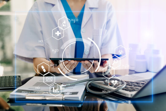 medical technology concept,smart doctor hand working with modern laptop computer with his team virtual icon