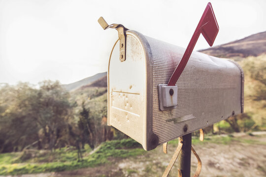Metal Mail Box With Typical American Style, Behind You See A Countryside Landscape