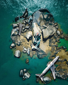 Aerial view of a commercial plane crashed on the ground along the river on the rocks, Xiamen, China.