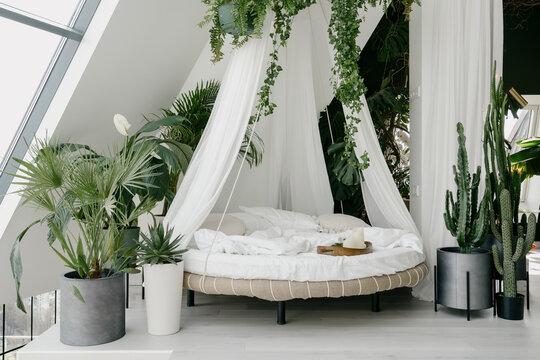 White bedroom with boho chic interior design