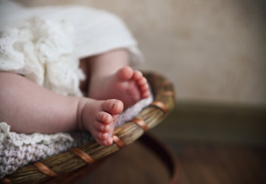Low Section Of Baby Relaxing In Basket