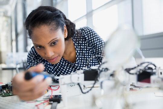Focused engineer assembling robot