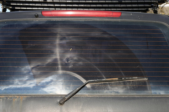trace from the wiper on the rear window of the car