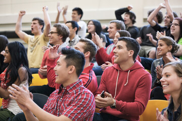 Large group of students cheering at college sporting event