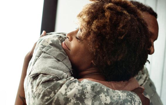 Military husband hugging his wife