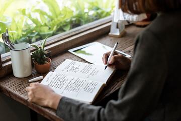 Fototapeta Closeup of girl writing on her journal obraz