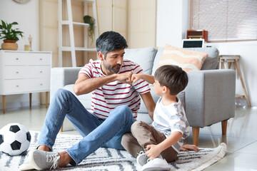 Fototapeta Father and little son having fun at home obraz