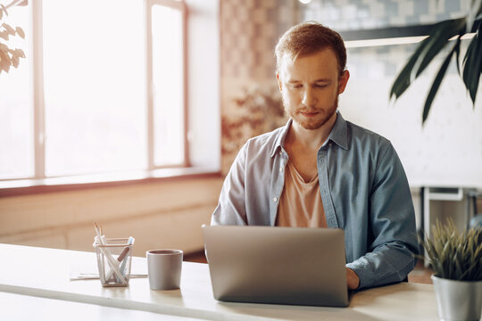 Young businessman working on computer in the office