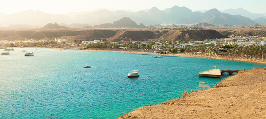 Panorama of Sharm el-Sheikh, Sharm El Maya bay. Red sea and Sinai mountains on a background. Tours to Egypt, travel and tourism concept.
