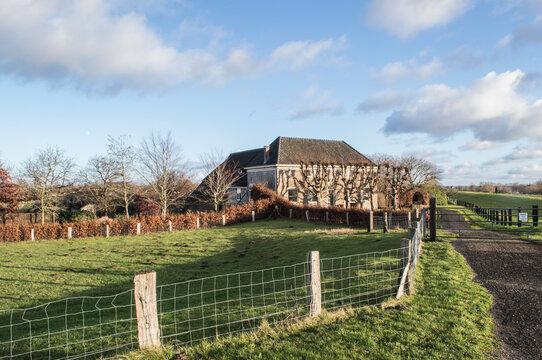 farmhouse in the wide, open polder near river IJssel