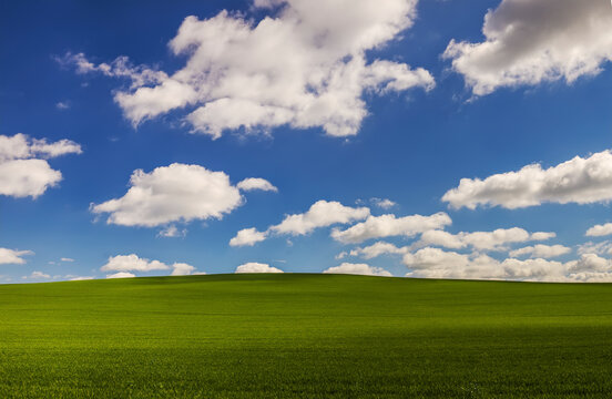 Hilly landscape with cloudy sky windows XP like background