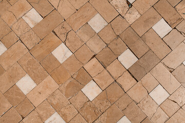 Fototapeta top view of old cracked brown multicolored ceramic tiles on the floor surface obraz