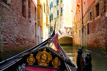 View of the small canal from a gondola in Venice, Italy.