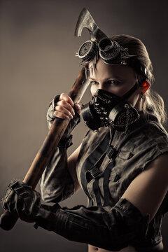 woman wearing cyberpunk style mask brandishing axe