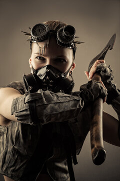 woman in cyberpunk style mask hit with an axe
