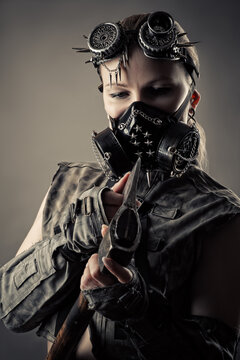 brutal woman in steampunk mask with axe