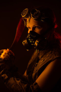 woman miner in a gas mask with kukri in hands