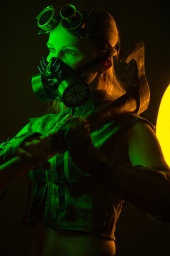 brutal woman with axe and steampunk mask in neon light