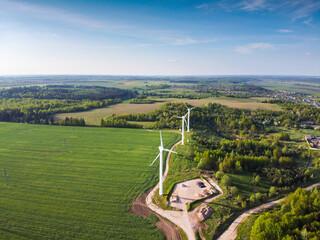 Wind turbines in green field, aerial view. Green energy - fototapety na wymiar