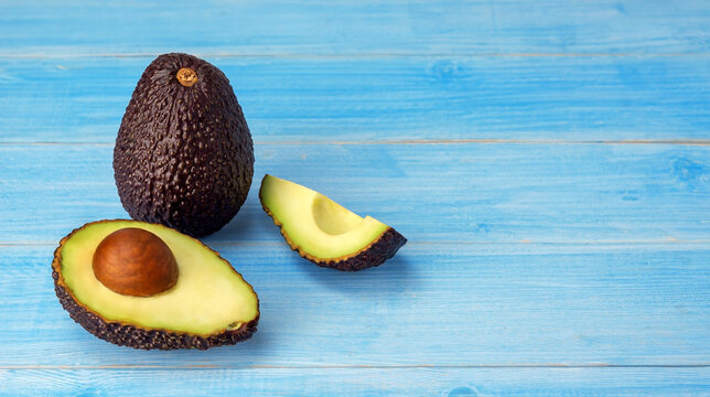 Avocado on a blue wooden table.