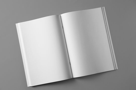 Open blank brochure on light grey background, top view