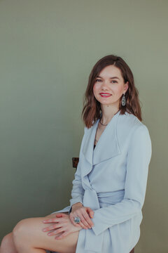 Portrait of a beautiful smiling woman sitting on a chair