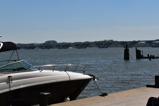 Boat Docked on the Potomac River with the Woodrow Wilson Bridge in the Background