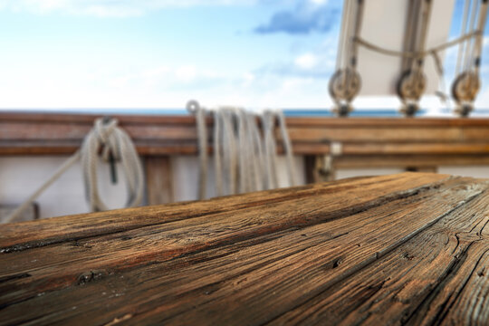 Wooden desk of free space and summer time on ship