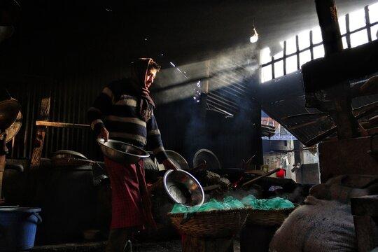 Man Working At Food Stall At Village Market