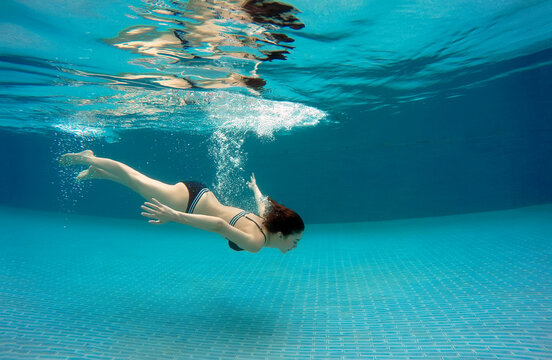 Sexy Woman Swimming Underwater In Water Pool In Summer Day Person