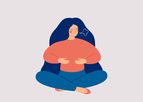 Woman makes Breathing exercise. Girl sits on the floor in pose lotus and makes a deep Inhalation. Recovery Respiratory system after illness. Health and wellbeing concept.