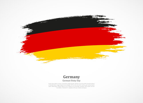 Happy german unity day of Germany with national flag on grunge texture