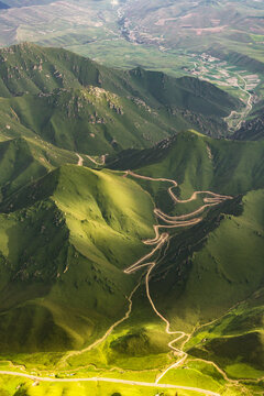 Aerial photos of mountains, grasslands and roads in Urumqi, Xinjiang Province, China